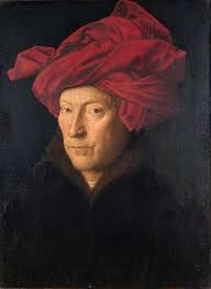 The chaperon is a headdress for men. Usually a long scarf that is thrown around their head in the manner of the portrait.
