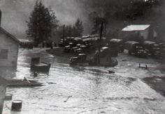 "Original caption reads: ""Mortimer CCC Warehouse & the Forest Service office with the 1940 flood waters were decreasing -- Truck was flooded with water."" Collection of Arnold and Tommy Sue Walker, Walnut Bottoms, NC."