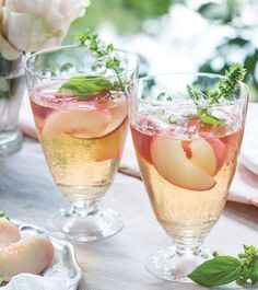 This White Peach Sangria is a refreshing blend of Peach-Basil Syrup, Pinot Grigio, grape juice, brandy, and peaches.