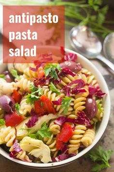 This vegan antipasto pasta salad is made with rotini pasta dressed in a tangy balsamic vinaigrette and tossed with artichoke hearts, marinated mushrooms, roasted red peppers, olives and herbs. This vegetarian side dish is a hit with everyone and perfect for summer cookouts! #veganrecipes #pastasalad #sidedish #cookout