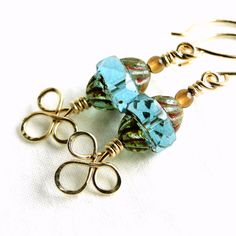 Handcrafted Jewelry, Aqua Blue Turbine Bead, Wire Wrapped Earrings, 14K Gold-filled Wire, Celtic Knot Earrings. $31.50, via Etsy.
