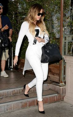 Khloe goes crazy off the black and white ensemble