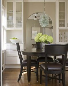 Creamy beige and brown dining room design with creamy greige walls, espresso dining table