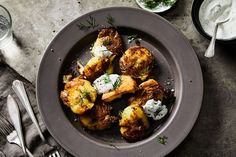Crisp-Smashed Yellow Potatoes with Sour Cream and Vinegar Dill Sauce recipe on Food52