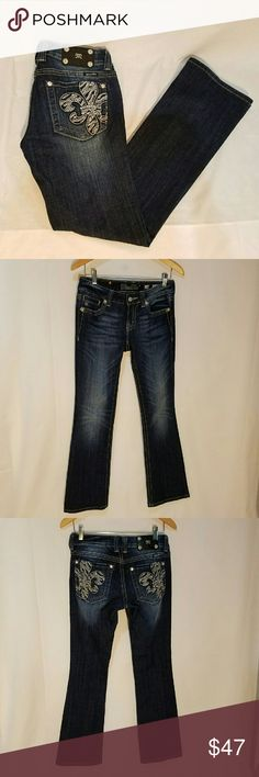 """Miss Me Boot Cut Embelisshed Fleur Di Lis Jeans This is a pair of Miss Me distressed boot cut jeans with a fleur di lis pattern, formed with rhinestones and metallic thread, on back pockets.  EUC Approximate Measurements - measured laying flat: Compare your favorite pants to these measurements to assure a good fit! Waist: 14"""" Rise: 7 3/4"""" Inseam Length: 32"""" eijxx2 Miss Me Jeans Boot Cut"""