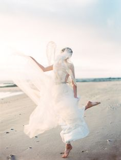 love the motion in this picture...Ethereal Seaside Wedding Ideas by Erich McVey