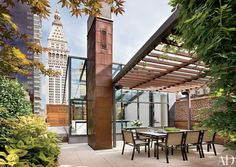 This Manhattan terrace's steel-and-glass structure is a skylight, proportioned to hold the stair that gives way to the outdoor room. Natural materials—copper, limestone, ipe wood, etc.—are emphasized by architect Charles Rose.
