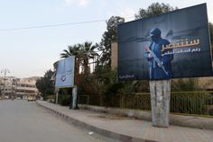 "Islamic State billboards are seen along a street in Raqqa, eastern Syria, which is controlled by the Islamic State, October The billboard (R) reads:. ""We will win despite the global coalition"" REUTERS/Nour Fourat Shiga, Trump Immigration, Syrian Refugees, Lead The Way, Water Conservation, European Countries, Special Forces, Iran, Christianity"