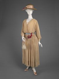 7-11-11  Afternoon Dress    Made in Paris, France  Summer 1916    Designed by Jeanne Lanvin, French, 1867 - 1946    Beige silk georgette trimmed with narrow strips of crystal beading  Center Front Length: 48 inches (121.9 cm) Waist: 27 inches (68.6 cm)