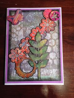 Upright vine with string flowers and laced circle. Handmade card using Gelli plate and mixed media.