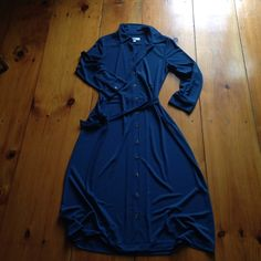 Isaac Mizrahi blue dress Easy button up work dress! 100% polyester. Doesn't wrinkle! Size small. 3/4 length sleeves.  Color is closest to last picture. Has optional belt for waist. Super easy! Isaac Mizrahi Dresses