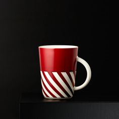 A new 12 fl oz ceramic coffee mug with a base striped like a candy cane & perfect for the 2015 holidays.
