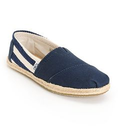 Take a page out of the sailor's fashion book and wear these Classic University Navy Stripe shoes by Toms. A great navy and cream canvas print paired with the jute detail will set your sailing outfit off. With every pair of Toms shoes bought, TOMS will pro
