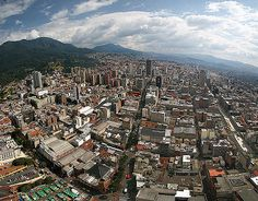 https://flic.kr/p/7P8P8Q | Bogota Panorama | Panoramic stitch taken from the 46th floor of the Colpatria tower building.  Bogota at 2600m. altitude is the second highest capital city in the world, means warm days, cool nights in the tropics.  Looking south at the central business district, Guadelupe mountain at left, market area at lower left corner.