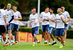 Sharp shooters Lionel Messi and Sergio Aguero shared a joke during training at Argentina's Azeira base