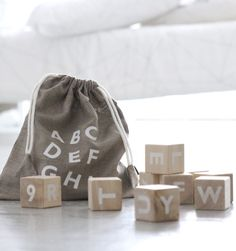 Traditional learning has never looked more beautiful than these wooden alphabet blocks from Ooh Noo. Set of 10 blocks are printed with the alphabet and Wooden Alphabet Blocks, Wooden Blocks Toys, Letter Blocks, Wood Blocks, Letters, Madeira Natural, Diy Bebe, Traditional Toys, Linen Bag