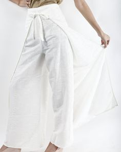 White palazzo wrap pants that ties in the front and back to allow for a perfect fit. High waist and wide legged. One size fits most, from size S up to