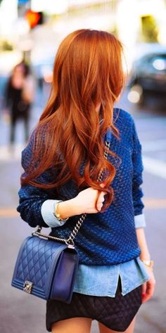 Attractive blue sweater with mini skirt and shoulder bag