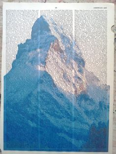 swiss mountain printed on old dictionary