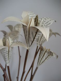 Old book page lily bouquet on natural sticks- upcycled origami- anniversary birthday gift-8 stems. £12.00, via Etsy.