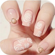 Pastel pink with white roses and pearls nails
