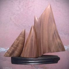 """A GALWAY HOOKER BOAT ,MADE FROM BOG WOOD AND WALNUT.THE SAILS ARE MOVEABLE AND ALSO AVAILABLE IN OLD MAHOGANY,OAK AND MAPLE. SIZE 9 INCH HIGH /9 INCH LONG /3 INCH WIDE.  Please contact seller via """"Contact Seller"""" link to choose Mahogany, Oak and Maple or Walnut.  The Galway Hooker is a traditional sailing vessel of Galway Bay.A single mast with a main sail and two foresails. The sails are a dark red or brown.This sturdy workboat would haul turf fuel ... Interior Accessories, Soft Furnishings, Dark Red, Sailing, Irish, Boat, Traditional, Link, Design"""