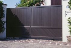 46 Inspiring Modern Home Gates Design Ideas is part of Modern home Entrance - Gates are an important part of your home and can create a huge impression on the minds of those who […] Home Gate Design, Front Gate Design, Main Gate Design, Home Building Design, Garage Door Design, Garage Gate, Garage Doors, Modern Entrance, Entrance Gates