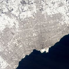 """""""#Toronto, looks cold eh?"""" #AstroButch  Photo Credit Barry Wilmore: 127F1267  #nasa #nasajsc #spacestation #internationalspacestation #explore #exploration #photography #ISS #Exp42 #cupola #geography #EarthArt #moment #space #environment"""