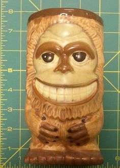 19 oz  ceramic Big Foot Tiki Mug - New In Box - cute mug with buns on the back.  Clicking on the view page button will take you to our eBay store listing for this mug.  When you click the following link, it will take you to our Way Up In Alaska Novelties & Fun Stuff Page :  http://www.wayupinalaska.com/Novelties---Fun-Stuff.html