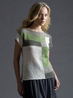 Geometric blocks of color decorate this stylish top. The masterful placement of the blocks in this top is what makes the finished look really pop -- plus the unique use of complementary colors and textural yarn. Knit with 2 (3, 3, 3, 4, 4) balls of...