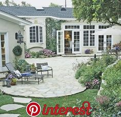 Patio Design Tips - Better Homes & Gardens - Soften with Curving Lines Sometimes a problem can be turned into an asset. Rugged terrain determined the gracious, curved shape of this patio. It is easily accessible from the house through French doors. Budget Patio, Patio Diy, Backyard Patio, Backyard Landscaping, Patio Ideas, Landscaping Ideas, Pergola Ideas, Landscaping Around Deck, Patio Roof
