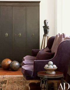 In a corner of the office are a vintage industrial cabinet, a Victorian wingback settee, and an 18th-century Italian santo figure; the bronze side table was found at Blackman Cruz.