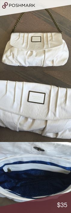 """Vera Wang Hand Bag! Beautiful Simply Vera cream-colored handbag with piping detailing on the front and an antiqued chain. It can be both a purse and a clutch! I have literally never used this bag - it's unfortunately just been sitting away in my closet and needs a new home! The small imperfections in it are from storage. Royal blue interior with a zipper pocket and two small pockets. 13"""" long, 7"""" tall, and 2"""" wide with room to give based on its shape. Looking for a good home!! Vera Wang Bags"""