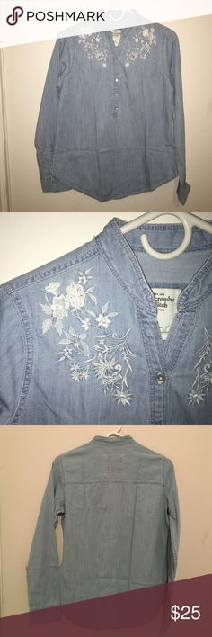 Abercrombie & Fitch chambray shirt size M This shirt from Abercrombie & Fitch is a size m. Brand new with tags. Has floral embroidery at front neck. Fabric content is 100% cotton. Abercrombie & Fitch Tops