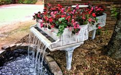 Old piano turned into outdoor fountain....because you probably can't bear to part with it, no matter the state of disrepair...