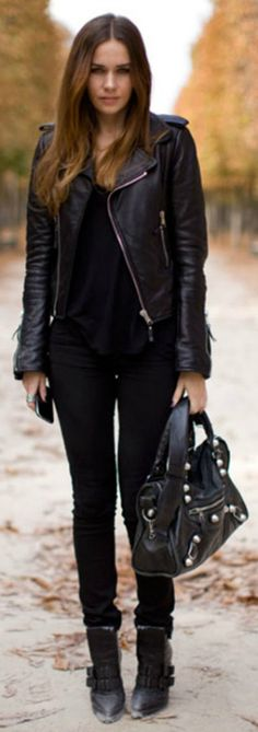 All black outfit + Caroline Blomst + striking composition + leather jacket + skinny black jeans + leather accessories + boots + Caroline's rocker girl style.  Brands not specified.