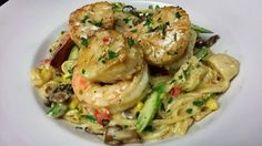 Shrimp, Scallop and Mixed Vegetable Fettuccine in a Clam Creme Sauce - Chef Dadisi Olutosin