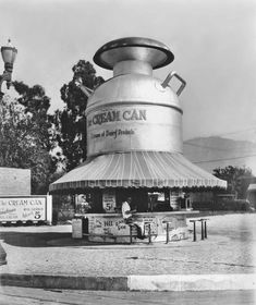 I couldn't find out where the Cream Can was located other than it was somewhere in Los Angeles. This photo was taken in 1928, when L.A. was still fairly sparsely populated, so it's fairly likely that this miraculous building really stood out. From what I can see, it served all things dairy: ice cream, buttermilk, cottage cheese, milkshakes. I have another photo that shows a sign that it also sold orange juice and root beer.
