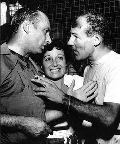 """Juan M. Fangio, his girlfriend Andrea """"Beba"""" Berruet and Moss"""