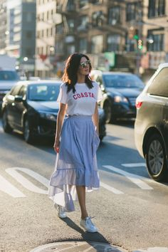 If you want to get on the sports trend, but you are not quite sure, a high-low skirt will do the trick for you. It will add a feminine touch to the look, and for the rest, you can add sneakers and a printed shirt.