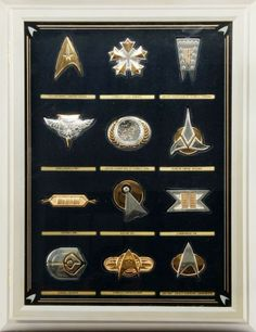 STAR TREK INSIGNIA COLLECTION SET 12 SILVER PIECES  The Official Star Trek Insignia Collection (Franklin Mint), includes twelve insignias minted in solid sterling silver, some with 24-karat plate. Consist of USS Enterprise Command, Starfleet Flag Admiral, United Federation of Planets Pennant, Romulan Bird of Prey, United Federation of Planets Seal, Klingon Empire, Captains Bar, Vulcan Idic, Commander Pin, Ferengi, Starfleet Officers Bar, and Star Trek: The Next Generation Communicator.