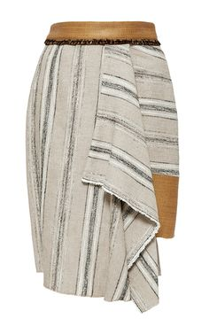 Rendered in a striped cotton blend, this **Sophie Theallet** skirt features a high rise with a fitted raffia waistband, a draped detail at the front, and a mini length asymmetric silhouette with in-seam side pockets.