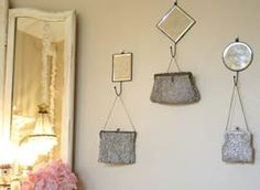 Vintage purses hung from hooked mirrors.