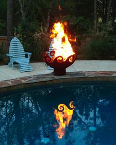 Rimmer in Madison, Mississippi sent in these dramatic photos of his Waves O' Fire Sculptural Firebowl™ that show how lovely the fire is when reflected in a pool. There's something very poetic about the flame from a Waves O Fire being doubled in the water of the pool.  The fish design chaise chairs are awesome— would love to know where he found those. Thanks for the photos, Rimmer!