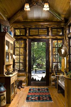 Rustic Entry. Would go a little more minimal myself but I love the wood