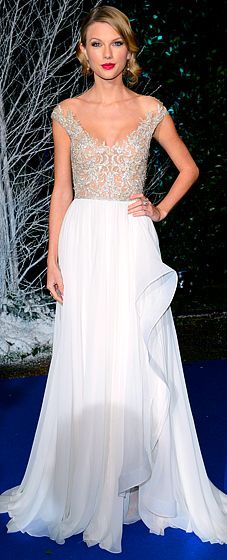 Taylor Swift at the Winter Whites Gala in a stunning, off-the-shoulder, crystallized bodice gown from Reem Acra's spring 2014 collection