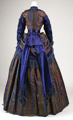 Back view of a Silk Dress, circa 1869-1872. Via http://thepragmaticcostumer.wordpress.com/.