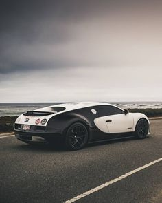 The Bugatti was unveiled in Paris in 1991 and went into production until Bugatti went out of business in 1995 (Bugatti has since been resurrected by Volkswagen). The car was available as a two-door sports car and only 31 cars were produced. Fast Sports Cars, Luxury Sports Cars, Exotic Sports Cars, Super Sport Cars, Fast Cars, Exotic Cars, Bugatti Veyron, Bugatti Cars, Supercars