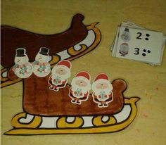 Thema kerstmis: kijk naar het kaartje en plaats evenveel kerstmannen, rendieren of sneeuwmannen in de slee!