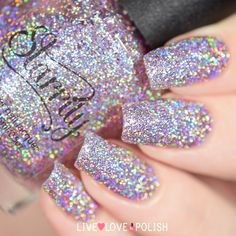 Simply Nailogical: My Cat's first Nail Polish - Menchie the Cat! Large holographic silver particles.